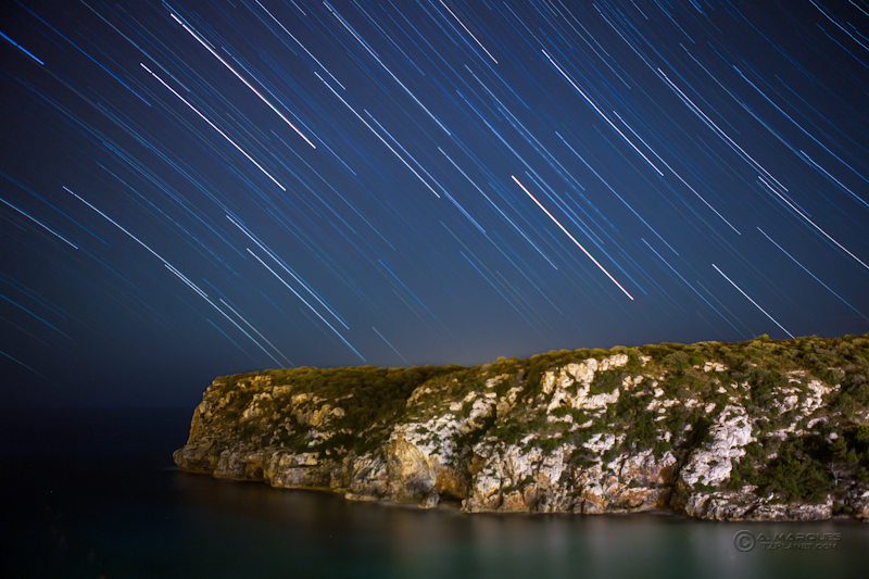 Travelling Stars - Star trails over Cala'n Porter, Menorca, Spain.