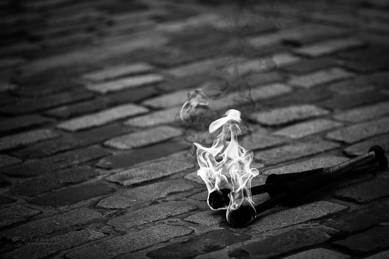 Let it Burn - Juggling torches left alight on the cobblestones of the Royal Mile, Edinburgh, Scotland