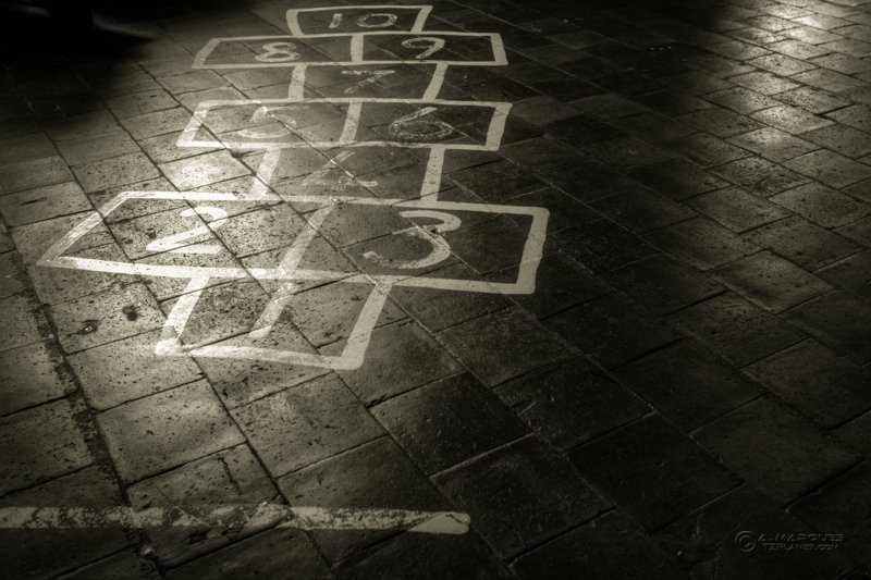 Hopscotch painted on a tiled floor at the New Lanark Mill Visitors Centre, Scotland